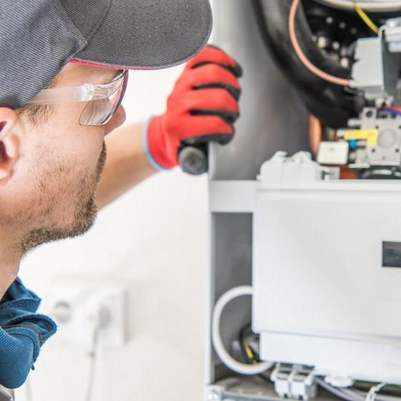 A man inspecting a heater.