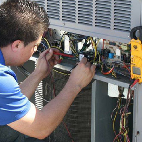 A Technician Maintains an Air Conditioner.