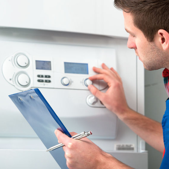 A man examining a thermostat.