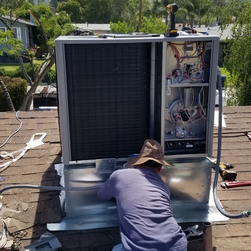 air conditioning service company technician working